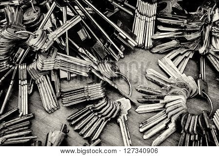 REIFKA - RUSSIA 9TH APRIL 2016 - Piles of blank metal house keys awaiting to be cut rest in a heap at a local market in Reifka, Russia