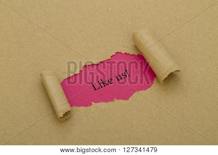 Like us word written under torn paper.