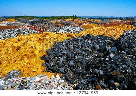 Field of colorful dumps of depleted iron ore