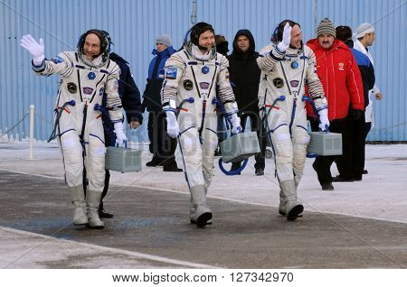 BAIKONUR, KAZAKHSTAN - DECEMBER 21, 2011: Expedition 31 crew (D.Pettit, O.Kononenko, A.Kuipers) walk out to report that they are ready for the flight to ISS at Baikonur cosmodrome