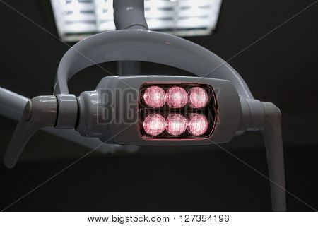 Glowing White Medical Shadowless Lamp With Yellow Pink In The Dark Room