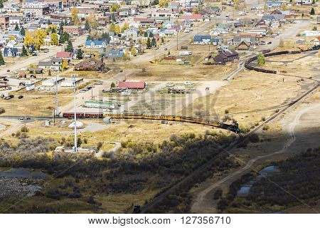 Aerial view of Silverton, Colorado in the fall with coal train and smoke