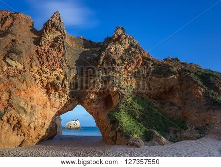 Mountain arch on the beach Portimao. Portugal.