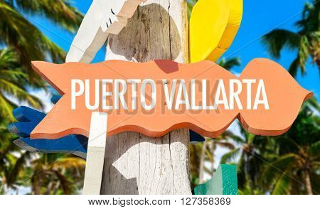 Puerto Vallarta signpost with palm trees