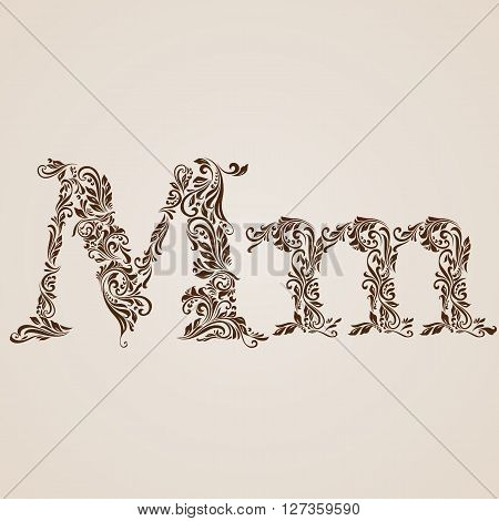 Handsomely decorated letter m in upper and lower case.