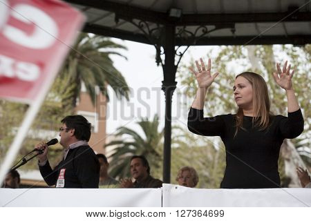 Badajoz Spain - March 29 2012: sign language woman interpreter gestures during a meeting that protests against austerity cuts