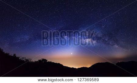 Panorama Milky Way Galaxy. Long exposure photograph.With grain