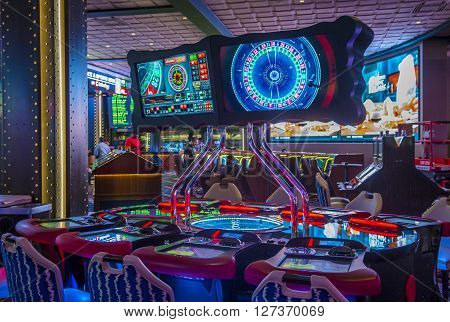 LAS VEGAS - APRIL 13 : The Cosmopolitan hotel casino interior in Las Vegas on April 13 2016. The Cosmopolitan opened in 2010 and it has 2995 rooms and 75000 sq ft casino.
