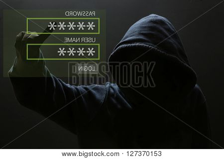 Silhouette of a hacker, Male thief typing password on virtual screen - computer hacker poster