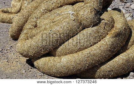 Construction erosion pollution control straw wattles industry closeup