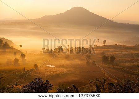 Misty morning sunrise in Khao Takhian Ngo View Point at Khao-kho PhetchabunThailand poster