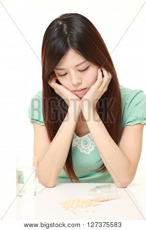young Japanese woman suffers from melancholy on white background