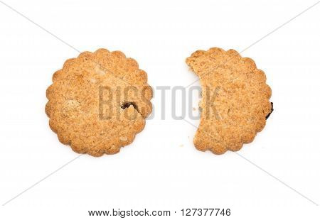 bited and intact crispy crackers with raisin on white