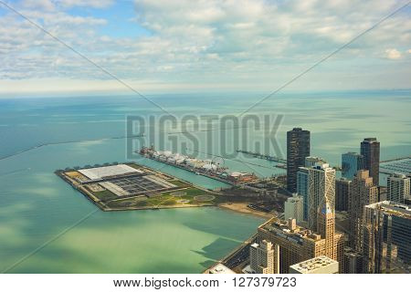 CHICAGO, IL - MARCH 28, 2016: view of Navy Pier from John Hancock Center. Navy Pier is a 3,300-foot-long pier on the Chicago shoreline of Lake Michigan.