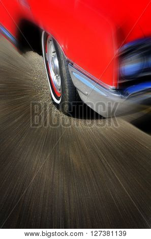Red car zooming effect for motion speed and driving on road