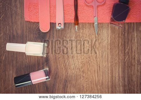 Vintage photo Cosmetics and accessories for manicure or pedicure nail file nail polish scissors nail clippers fluffy towel concept of nail care copy space for text