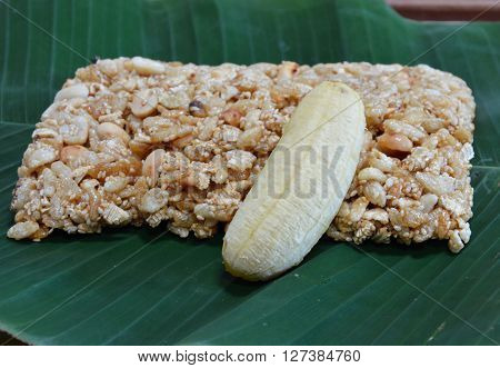 sweet made of rice nut sesame eat with golden banana for Thai merit day poster