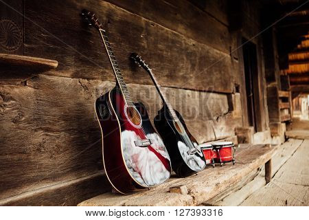 Guitar On A Wooden Porch