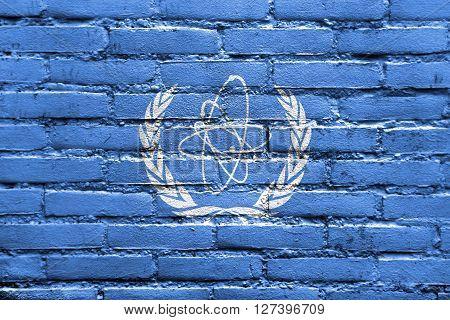 Flag Of The International Atomic Energy Agency (iaea), Painted On Brick Wall