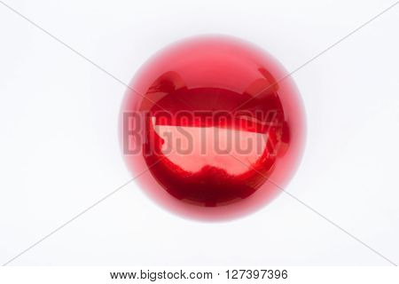 Shiny hard red ball on white background stock photo