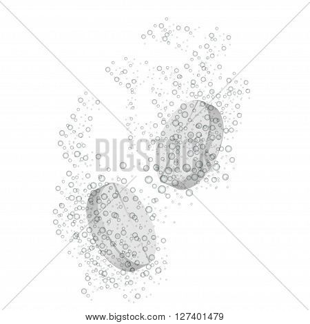 effervescent tablet under the water isolated on a white background