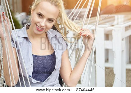 girl sitting on a hammock on the terrace