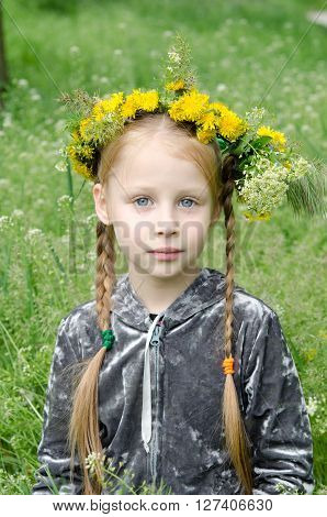 Girl Sitting In a Field with wreath on her head