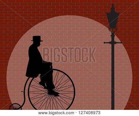 A gentleman riding a penny farthing shadow on a Brick Wall With Spotlight Background