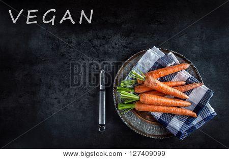 Carrot. Fresh Carrots bunch. Baby carrots. Raw fresh organic orange carrots. Healthy vegan vegetable food.