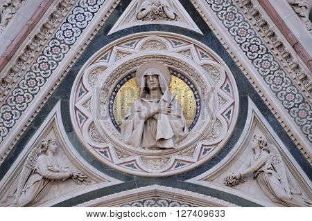 FLORENCE, ITALY - JUNE 05: Our Lady of Sorrows supported by Angels bearing Flowers, Portal of Cattedrale di Santa Maria del Fiore, Florence, Italy on June 05, 2015
