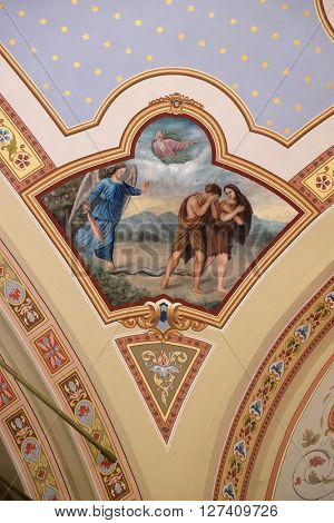 STITAR, CROATIA - AUGUST 27: Adam and Eve expelled from Paradise, fresco in the church of Saint Matthew in Stitar, Croatia on August 27, 2015