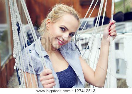 girl sitting on a hammock on the terrace