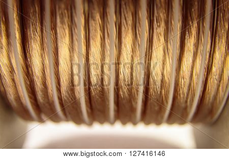 Closeup of golden coiled speaker wire - abstract concept