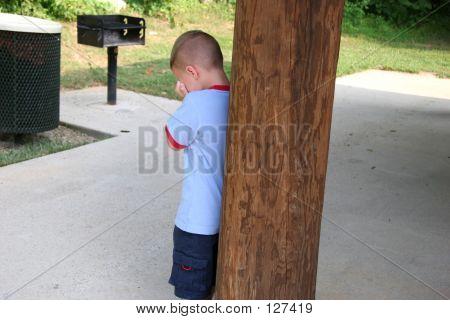 Boy Hiding Crying