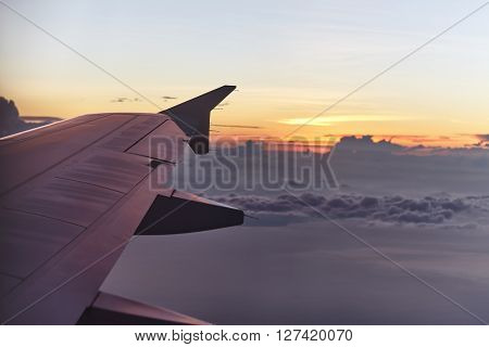 flying aircraft wing on beautiful sunset. Travel concept