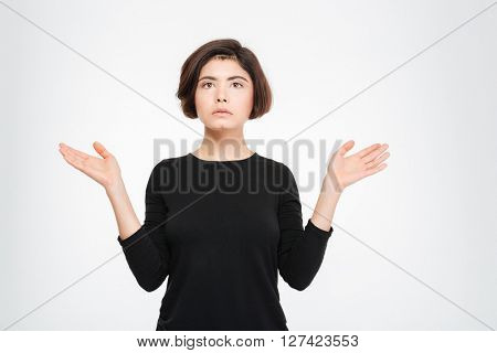 Pensive woman standing isolated on a white background