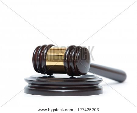 A wooden judge gavel and soundboard isolated on white background