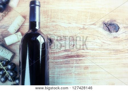 Setting with bottle of red wine grape and corks. Wine list concept with copy space
