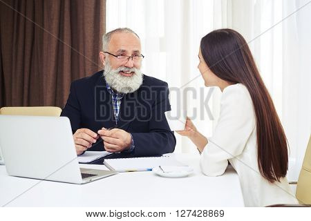 Businesswoman and businessman having informal meeting in office