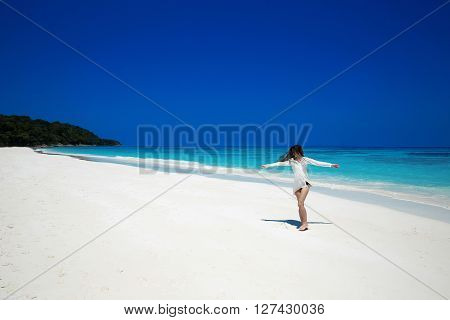 Enjoyment. Carefree Happy Woman Open Arms On Tropical Beach, Exotic Island. Summer Vacation. Brunett