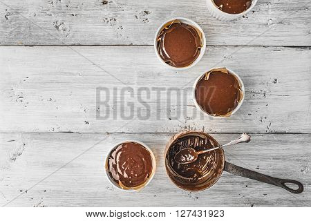 Chocolate dough for fondant in the ramekin horizontal