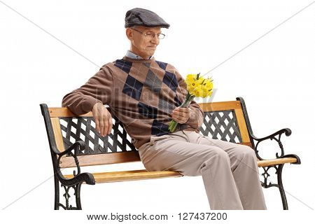 Stood up senior sitting on a wooden bench and waiting for his date isolated on white background
