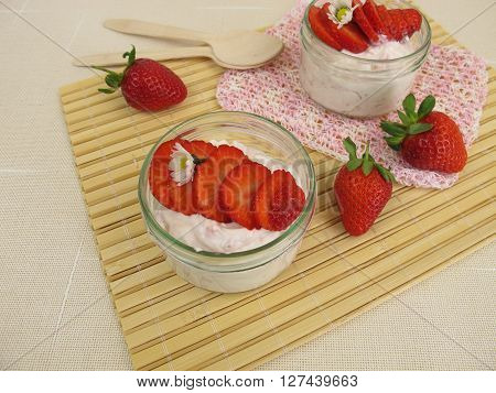 Strawberry milk quark in jars and fresh fruits