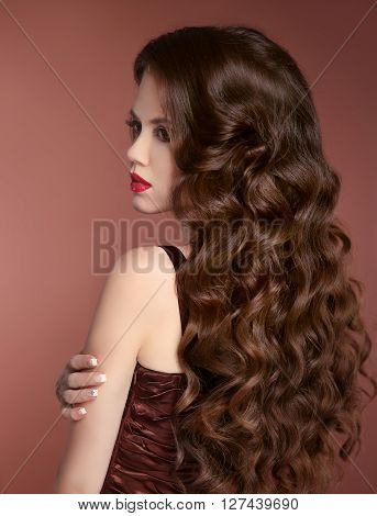 Healthy Hair. Wavy Hairstyle. Beauty Girl Fashion Portrait. Beautiful Young Woman With Long Curly Ha