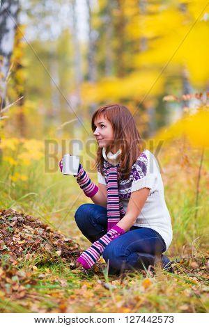 Pretty Woman In An Autumn Park