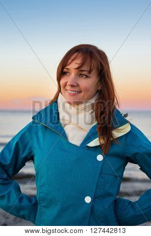 Woman On The Cost Of The Lake In Sunset Lights