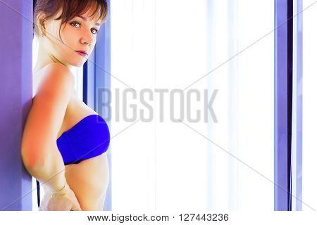 Pretty Slim Woman Getting Sun Tan In Solarium