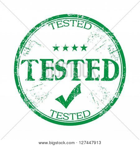 Green grunge rubber stamp with the word tested written with capital letters