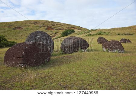 Vaka Kipo. Small volcanic cone of red rock used as the source of hats for some of ancient Moai statues on Easter Island.