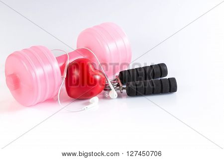 Fitness background with dumbbell handgrip and heart